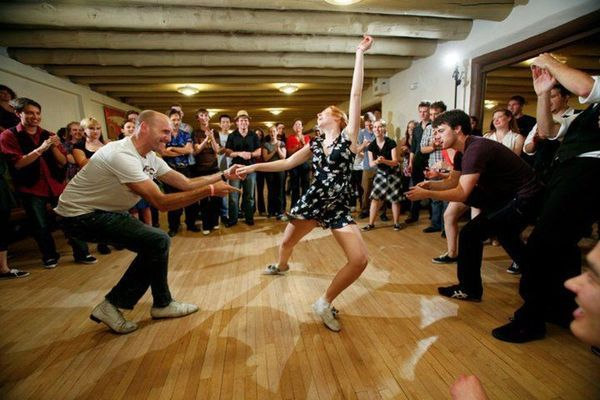 host a swing dance lesson at the event