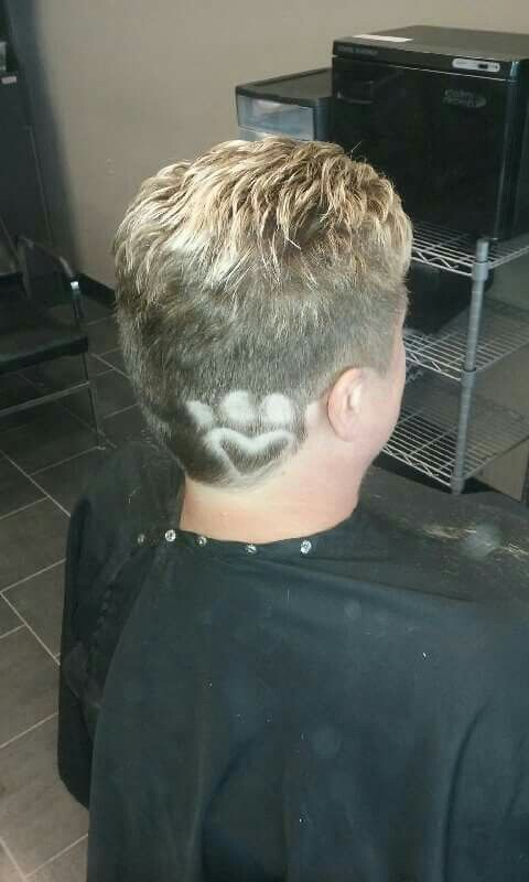 Paw print hair tattoo.  Super fun short hair @jagged_edges_salon