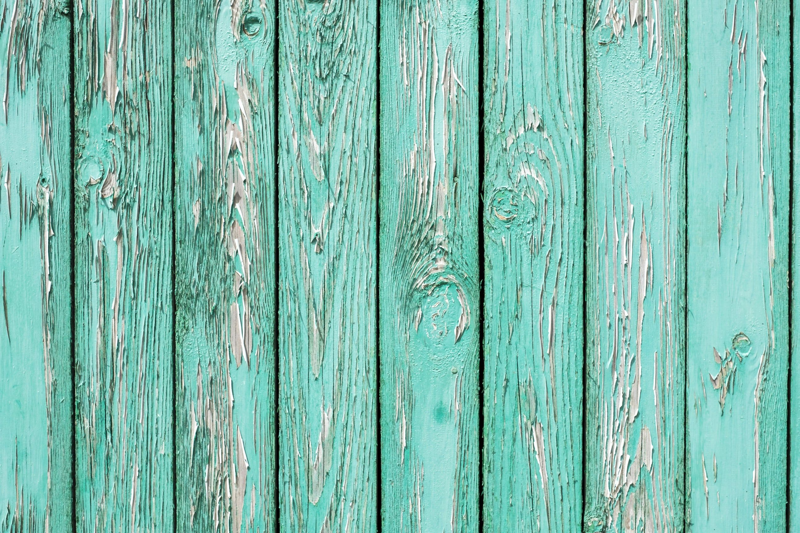 An Old Wooden Wall Painted Turquoise Cracked Paint Blue