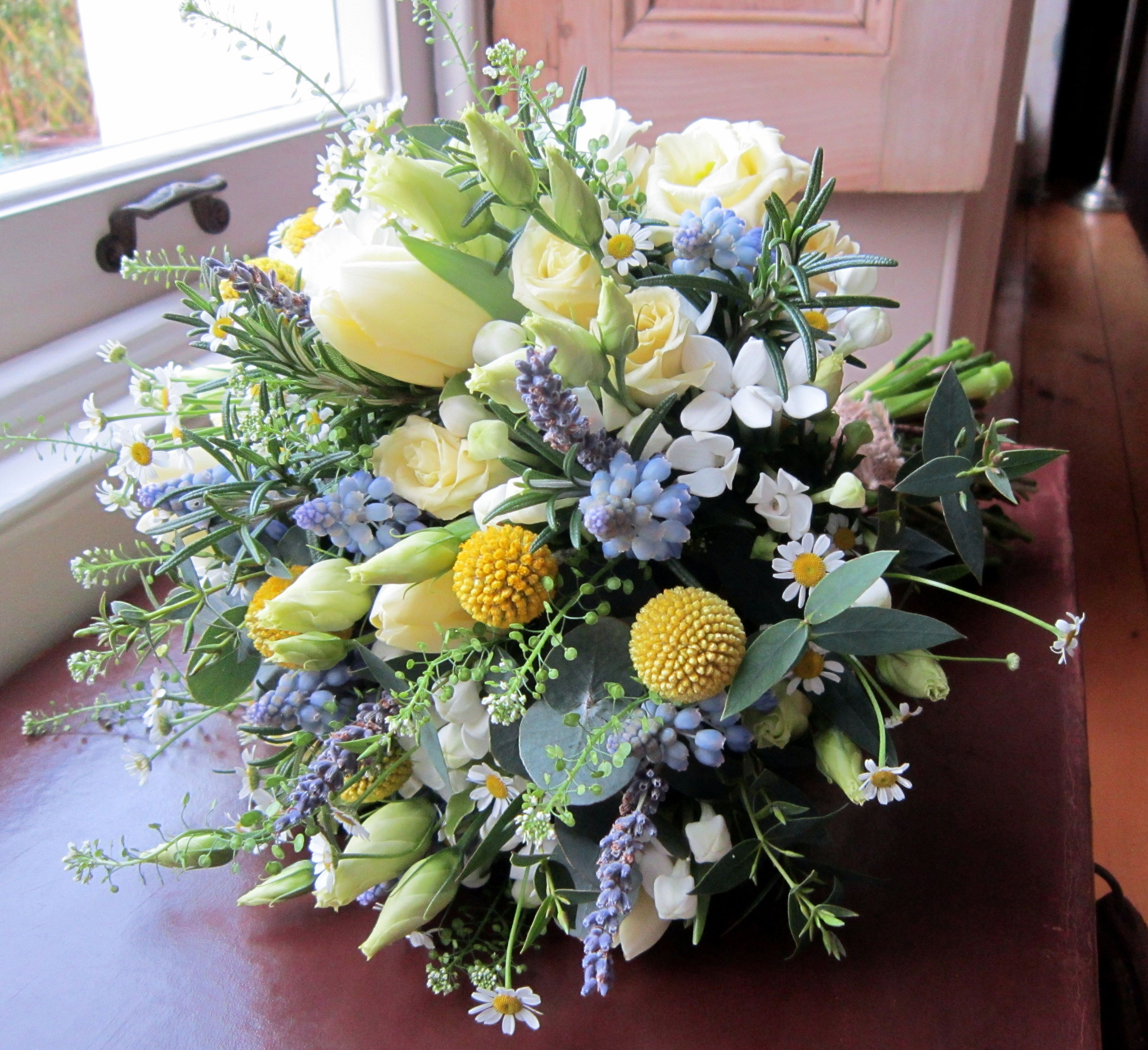 Very natural handtied bouquet of herbs blue grape hyacinths very natural handtied bouquet of herbs blue grape hyacinths lemon tulips white daisies dhlflorist Choice Image