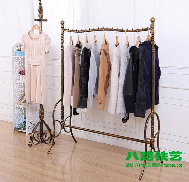Kleiderständer Schmiedeeisen wrought iron high end clothing shelves floor display shelf hang