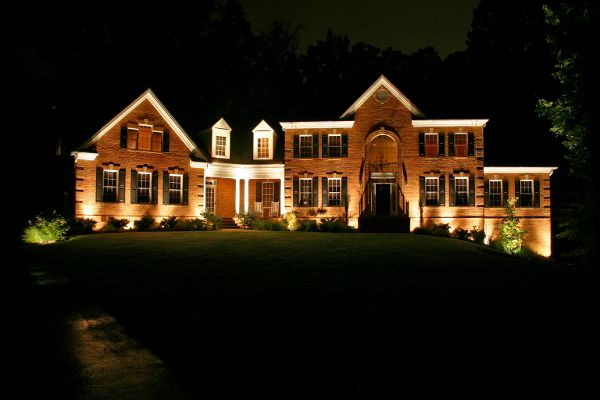Outdoor Lighting on Large Brick Cleveland Home - I love the way the lighting hits all the peaks on the facade of the house : home exterior lighting - azcodes.com