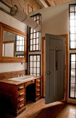 desk used as vanity. Old wooden office desk used as a bathroom sink and vanity