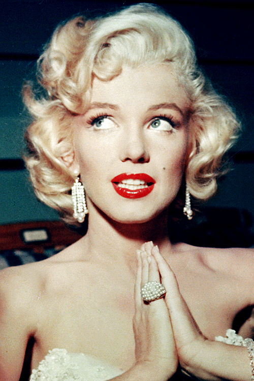 *f* Marilyn Monroe on the set of the Jack Benny Show