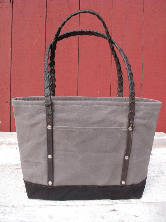 Slate gray body with dark brown accent  -Waxed canvas exterior  -Exterior…