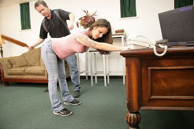 Hand spanked over jeans