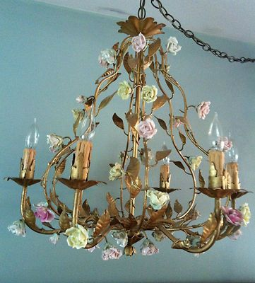 Something about  chandelier caught my eye.  Vintage , gilt italian  porcelain rose chandelier, birdcage style.