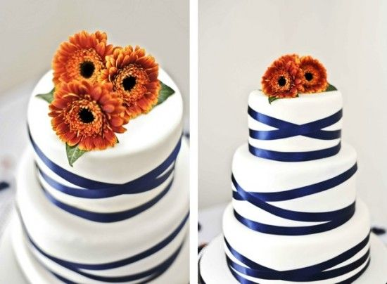 very simple wedding cake - a bit of ribbon and flowers - could be easily homemade!