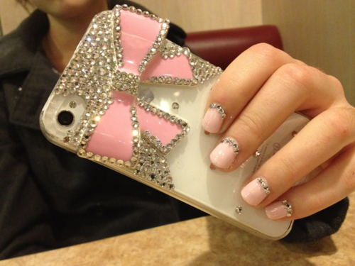 I can't decide whether my phone is more blingy or this one. Regardless... I need my nails done like that. Now.