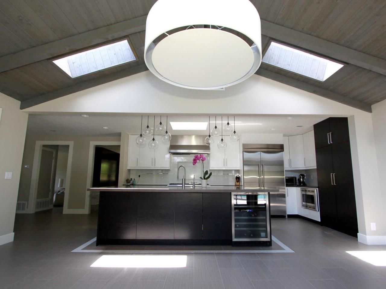 large kitchen pendant lights a large drum pendant light hangs from a vaulted ceiling in 6803