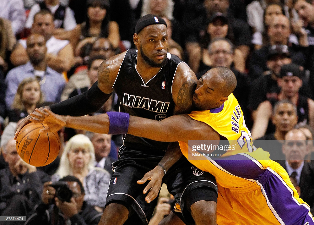 Lebron James Of The Miami Heat Is Guarded By Kobe Bryant Of The Los In 2020 Lebron James Miami Heat Kobe Bryant Kobe Bryant Black Mamba