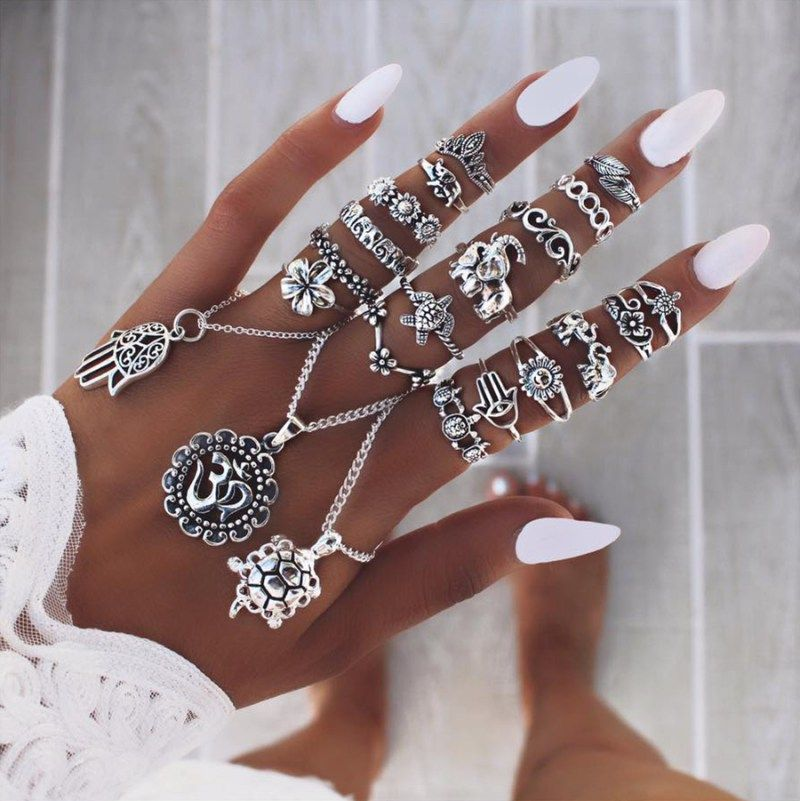 White nails with tanned skin and amazing rings!!