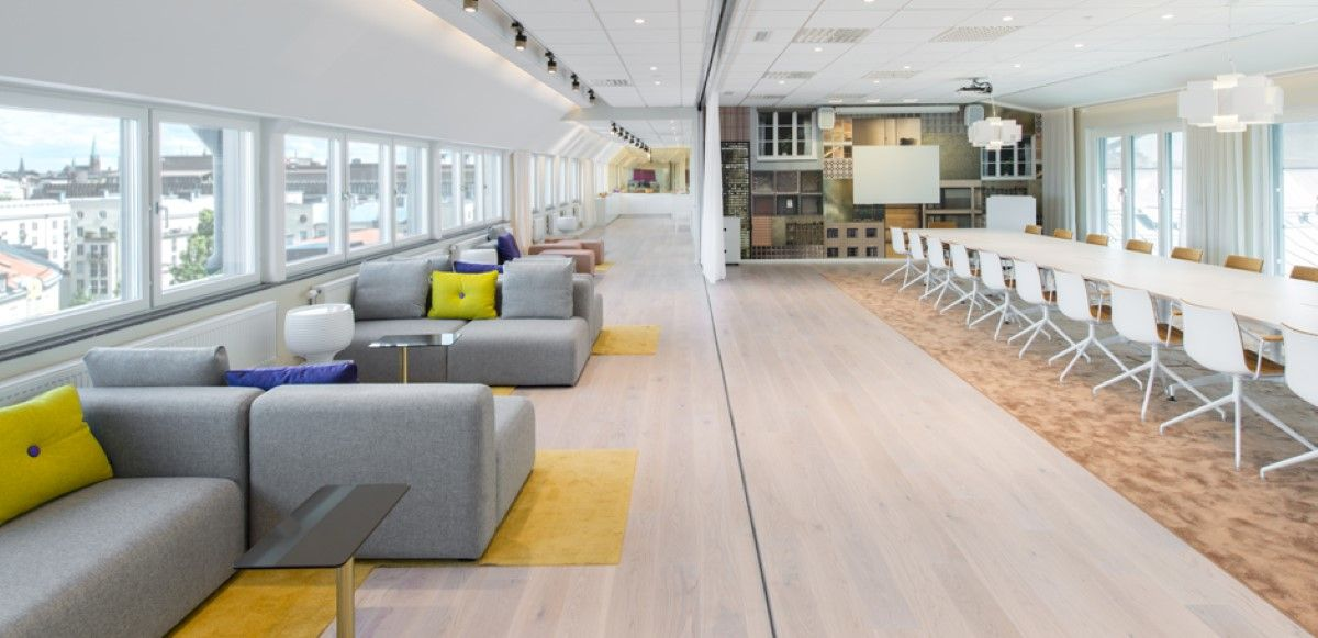Comfortable Meeting Area With Small Grey Sectional Sofa Plus Yellow Carpet On Wooden Laminate Floor Beside