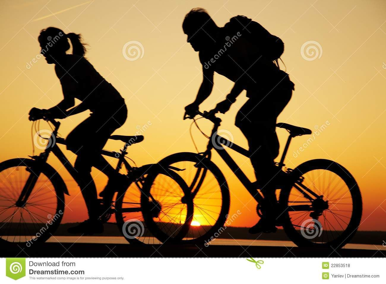 Family Riding Beach Bikes Young Couple Riding Bicycles At Sunset