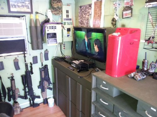 Military Man Cave Decor : Video games and guns this is a wheel drive man cave
