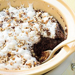 Delicious Rocky Road Chocolate Cake made in a slow cooker...if you use a liner for the slow cooker (in the shopping aisle near the foil, wax paper, etc.) then cleanup will be easy.