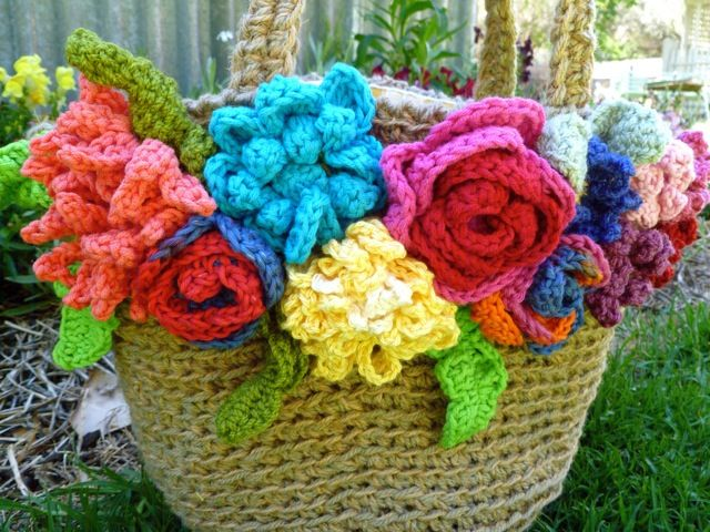 Inspiration....find a straw bag, add crocheted flowers, I could do this!