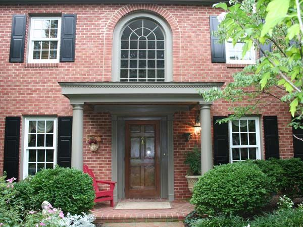 This Front Portico Covers The Large Brick Patio Of A Traditional - Colonial portico front entrance