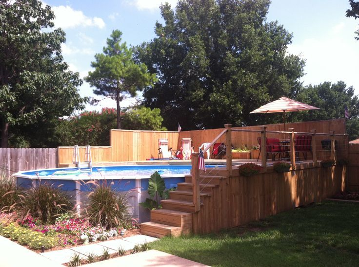 Above ground pool but build a deck around it and it looks - How to build an above ground swimming pool ...