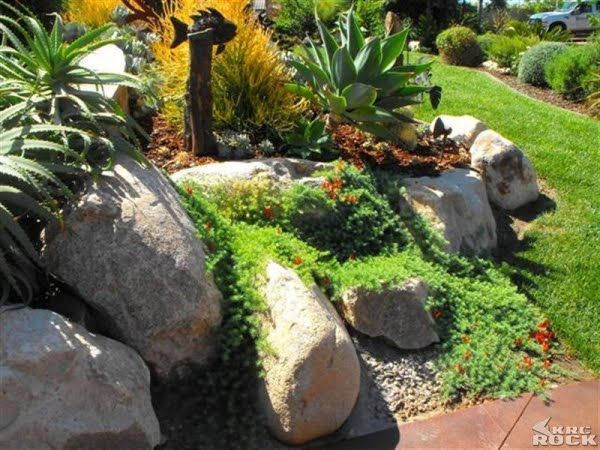 Image result for upward sloped backyard rock boulder retaining walls