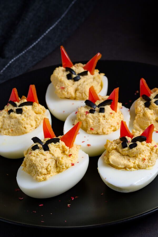 Creepy Halloween Deviled Eggs - Made with deviled eggs, black olives, green or red bell peppers | CDKitchen.com #halloweendeviledeggs Creepy Halloween Deviled Eggs - Made with deviled eggs, black olives, green or red bell peppers | CDKitchen.com #halloweendeviledeggs Creepy Halloween Deviled Eggs - Made with deviled eggs, black olives, green or red bell peppers | CDKitchen.com #halloweendeviledeggs Creepy Halloween Deviled Eggs - Made with deviled eggs, black olives, green or red bell peppers | #halloweendeviledeggs