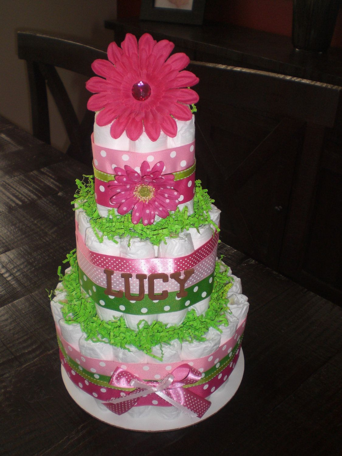Pink and green girl diaper cake baby shower centerpieces for Pink diaper bouquet