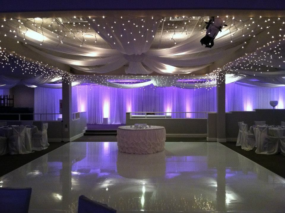Brilliant white dance floor ceiling canopy fabric backdrop with purple uplighting and wall draping. & Our team worked so hard on this look. Brilliant white dance floor ...