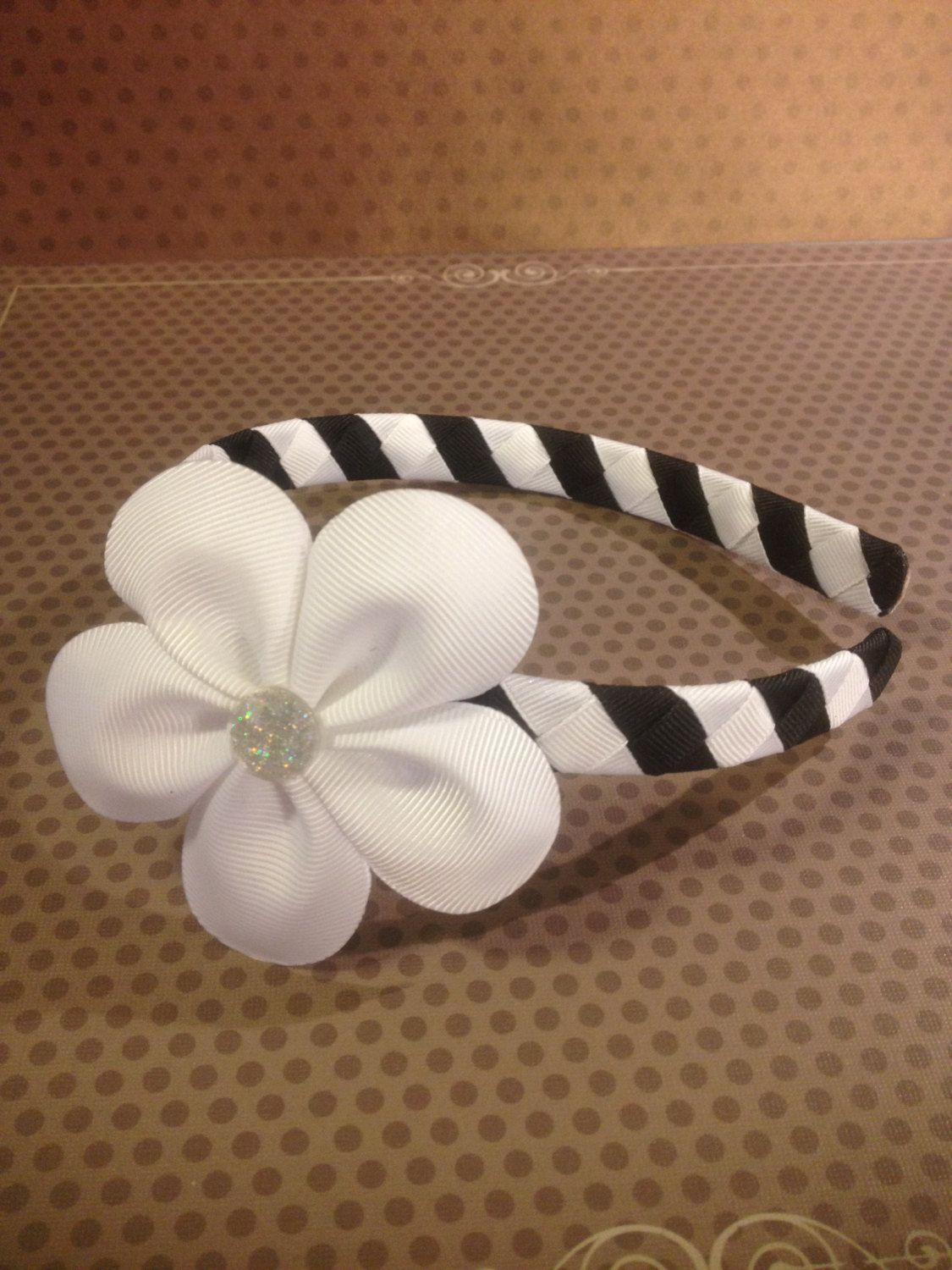 White Flower Hairclip With White And Black Woven Headbandrls