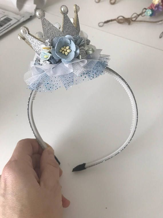 Silver Crown headband- Cinderella crown headband- Crown Birthday headband- Birthday Headband- Sparkle Birthday Crown headband- Baby Girl #crownheadband This is the cutest crown birthday hat headband. Silver and light blue and white Cinderella inspired sparkle crown headband with flowers, chiffon and tulle ruffle accents. #crownheadband