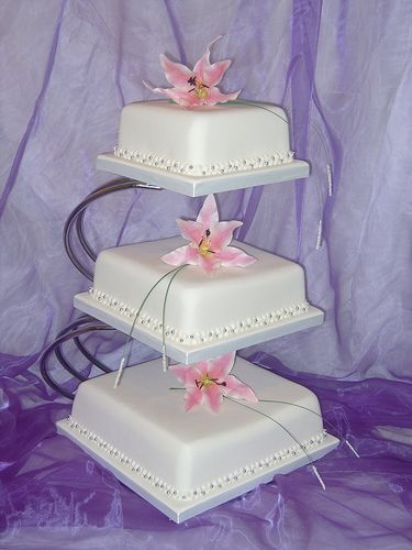 3 Tier Square Wedding Cake With Lillies On Stand In 2020 Square
