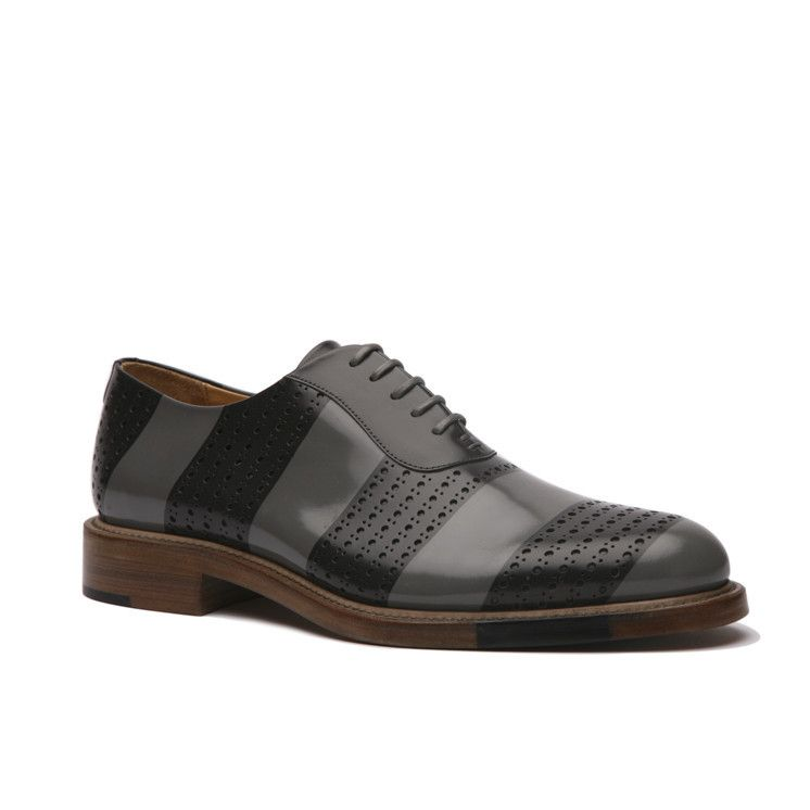 Men'sgreystriped oxford.Perforated brush off Italian leather upper. Calfskin lining with natural cork insole. Goodyear leather welted. Hand paintedoutso...