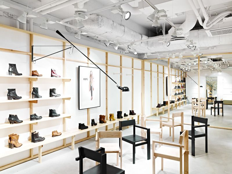 A European flagship store for Hope, blends classic and modern in their warm  retail environment