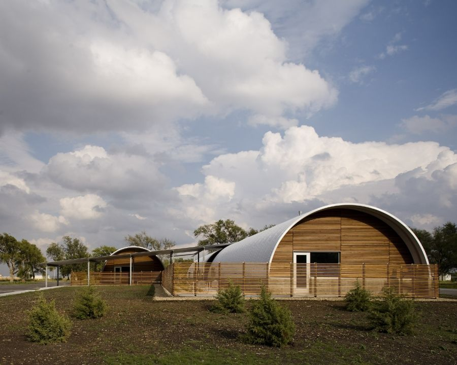 Nice combo of trad quonset hut with wood Custom Steel