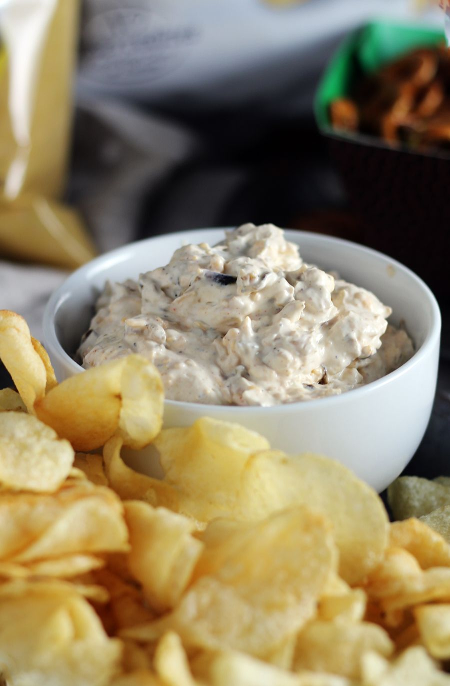 A Bowl Of Sour Cream Cheddar French Onion Dip Next To Kettle Cooked Potato Chips French Onion Dip Onion Dip Recipes