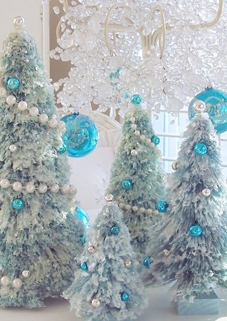 Snow covered aqua blue bottle brush christmas tree pearl garland ...