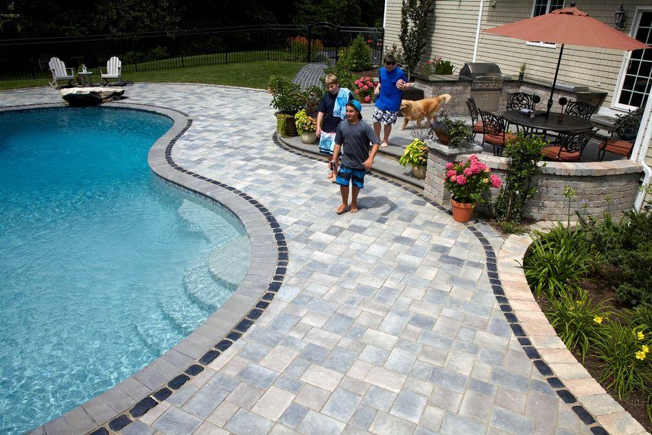 Residential Unilock Com Stone Pool Deck Backyard Pool Landscaping Stone Pool