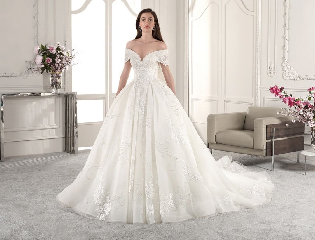 This off the shoulder ball gown transport us to the most dreamt of