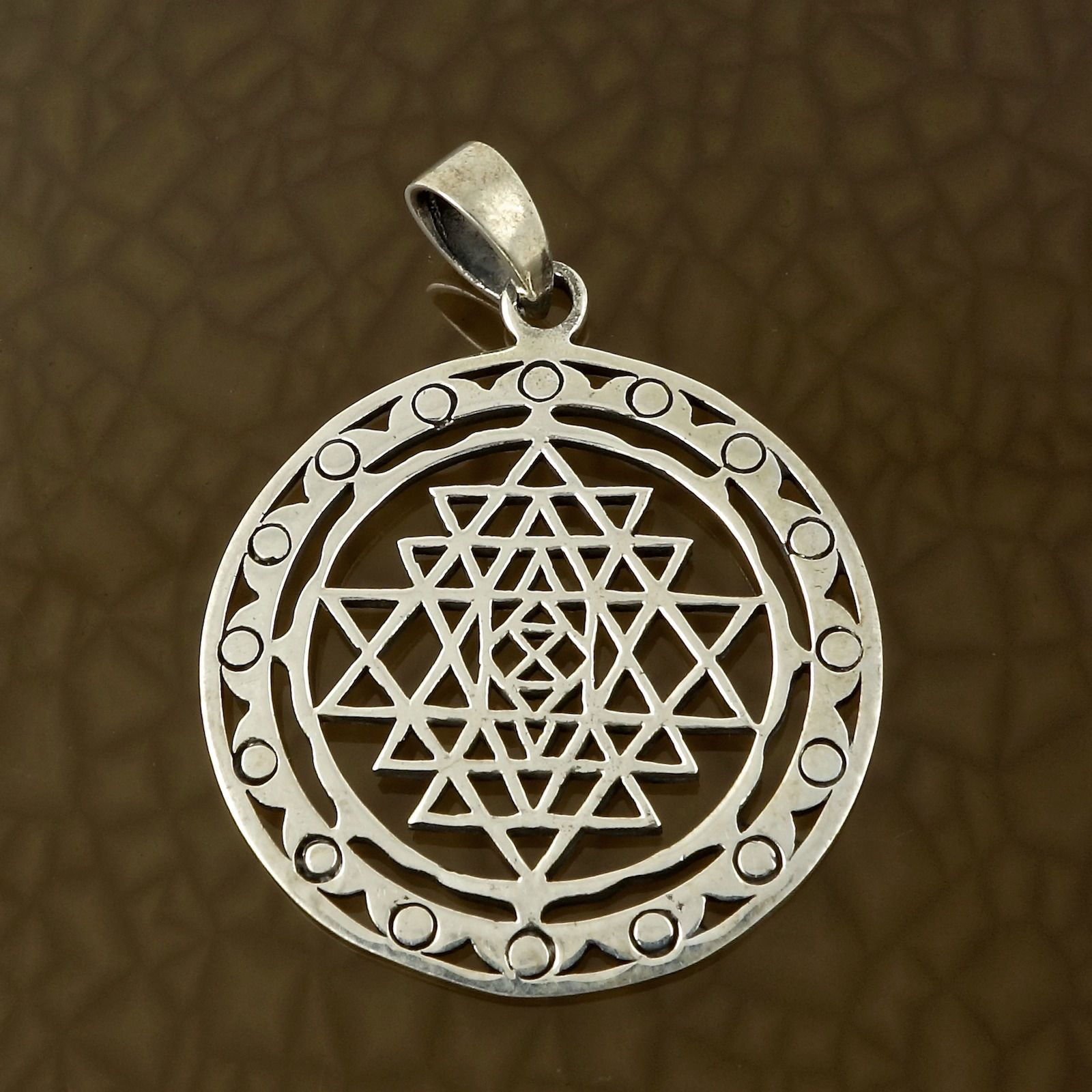 Sri yantra pendant in solid 925 sterling silver hindu tantric sri yantra pendant in solid 925 sterling silver hindu tantric charm this pendant depicts the classic hindu symbol for beauty of the three worlds buycottarizona