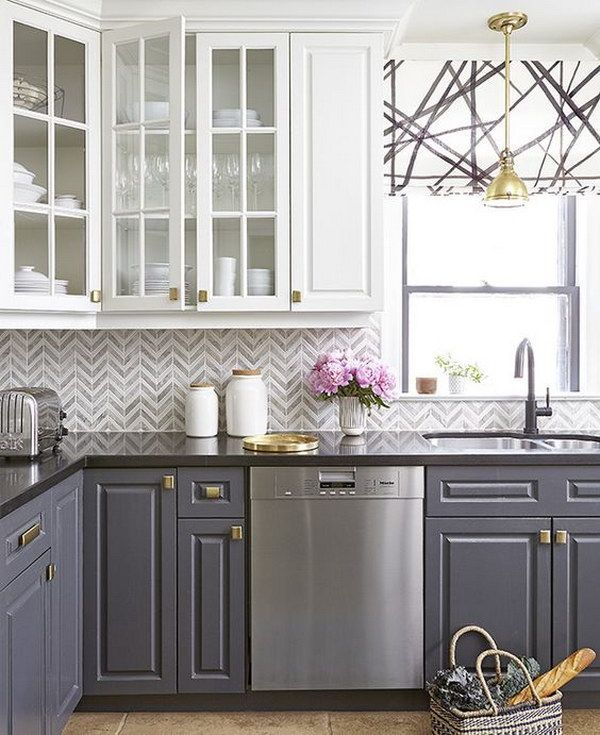 Grey and White Chevron Tile Backsplash in a Stylish Kitchen with Contrasting Cabinets