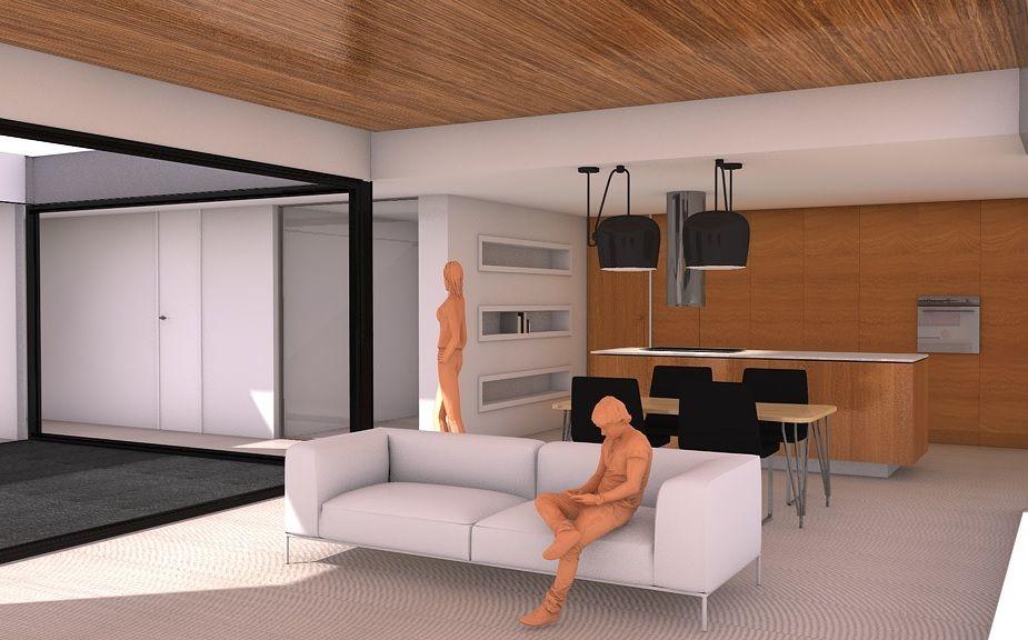 Salón-comedor-cocina en el que la madera cobra protagonismo, hasta alcanzar el techo, el cual parecerá flotar cuando se le instale una luz perimetral.