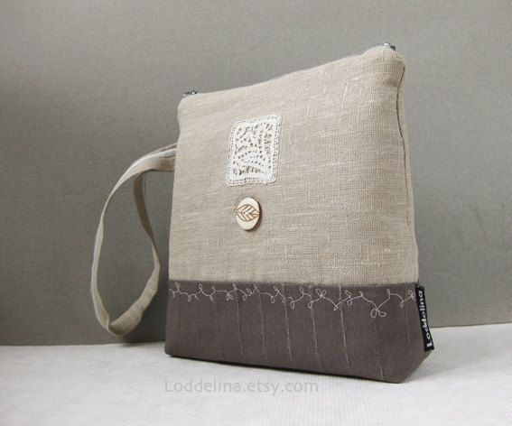 Natural linen canvas wristlet, large square shape, with handmade lace and emboidery. €37,00, via Etsy.