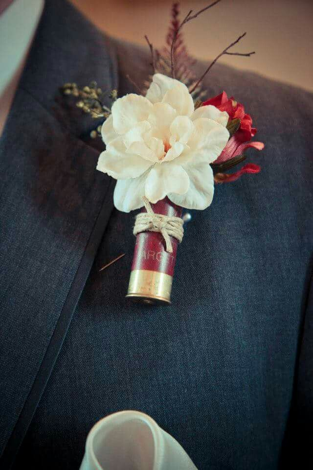 Shotgun shell boutonnieres. Everything except the shells came from Hobby Lobby. Hot glue and tada!