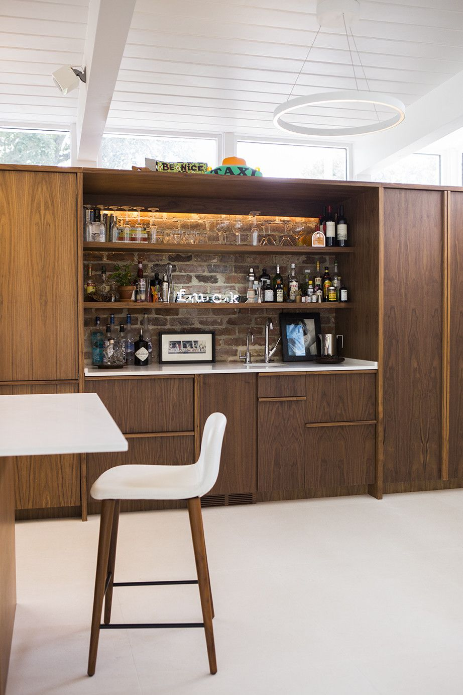 The kitchen and bar millwork is appleply with a walnut veneer
