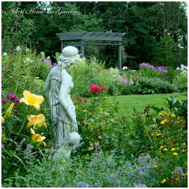 statues add so much interest to the garden \