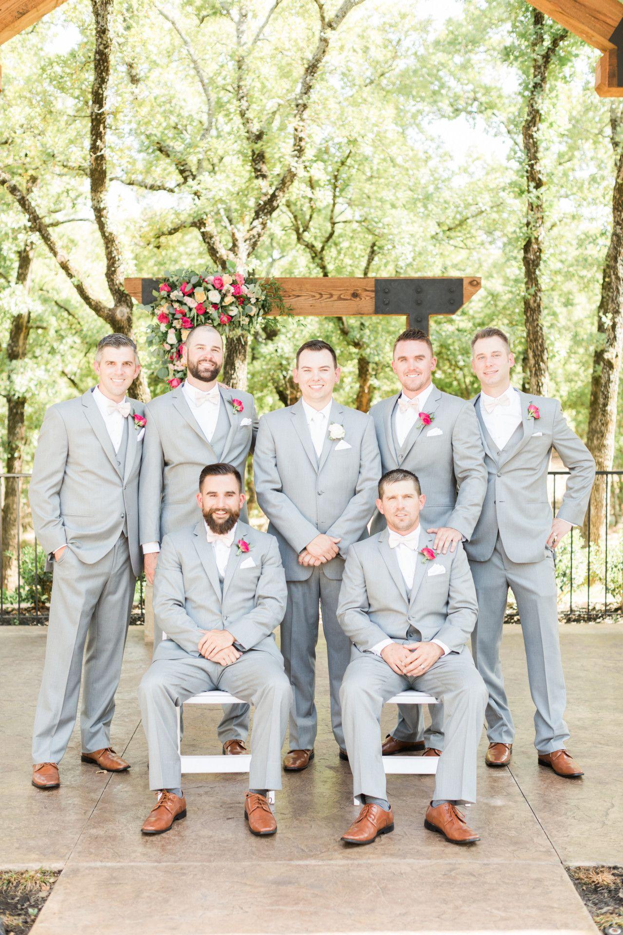 groomsmen in light gray suits groomsmen with hot pink