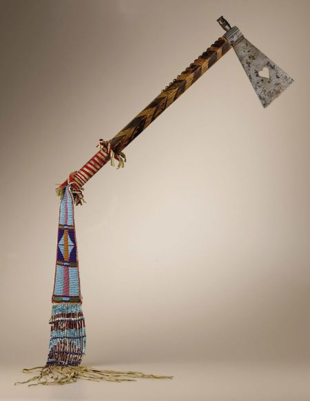 Crow Tomahawk with heart cutout and beaded and fringed   Lot #48136   Heritage Auctions
