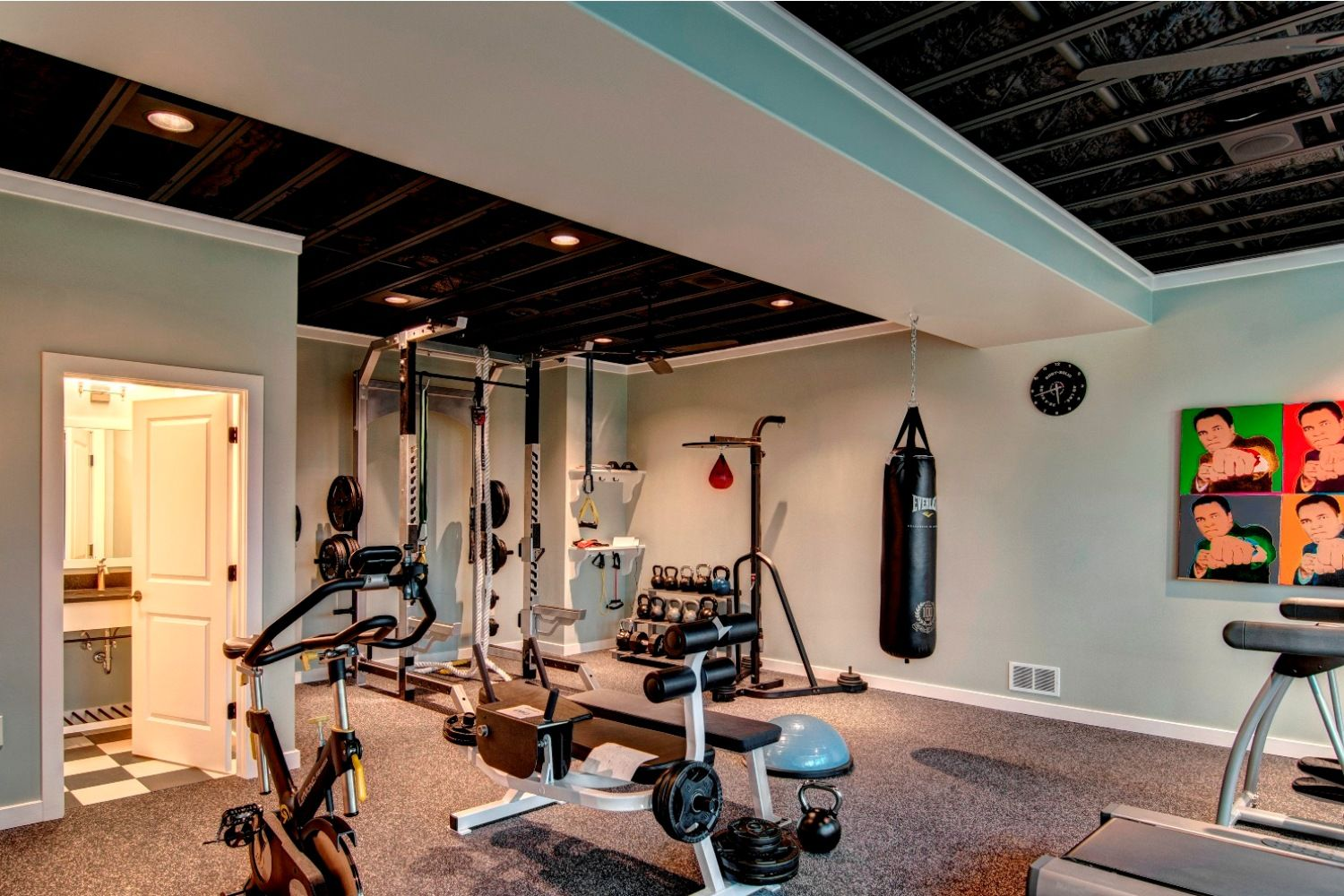 Love this design for a home gym. The exposed ceiling gives ...