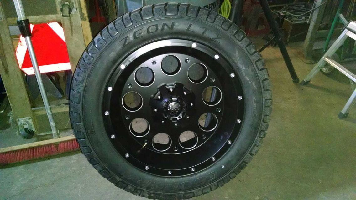 """Part 1 20"""" fuel revolver black milled wheels wrapped snugg in the 305 cooper zeon Ltz tire."""