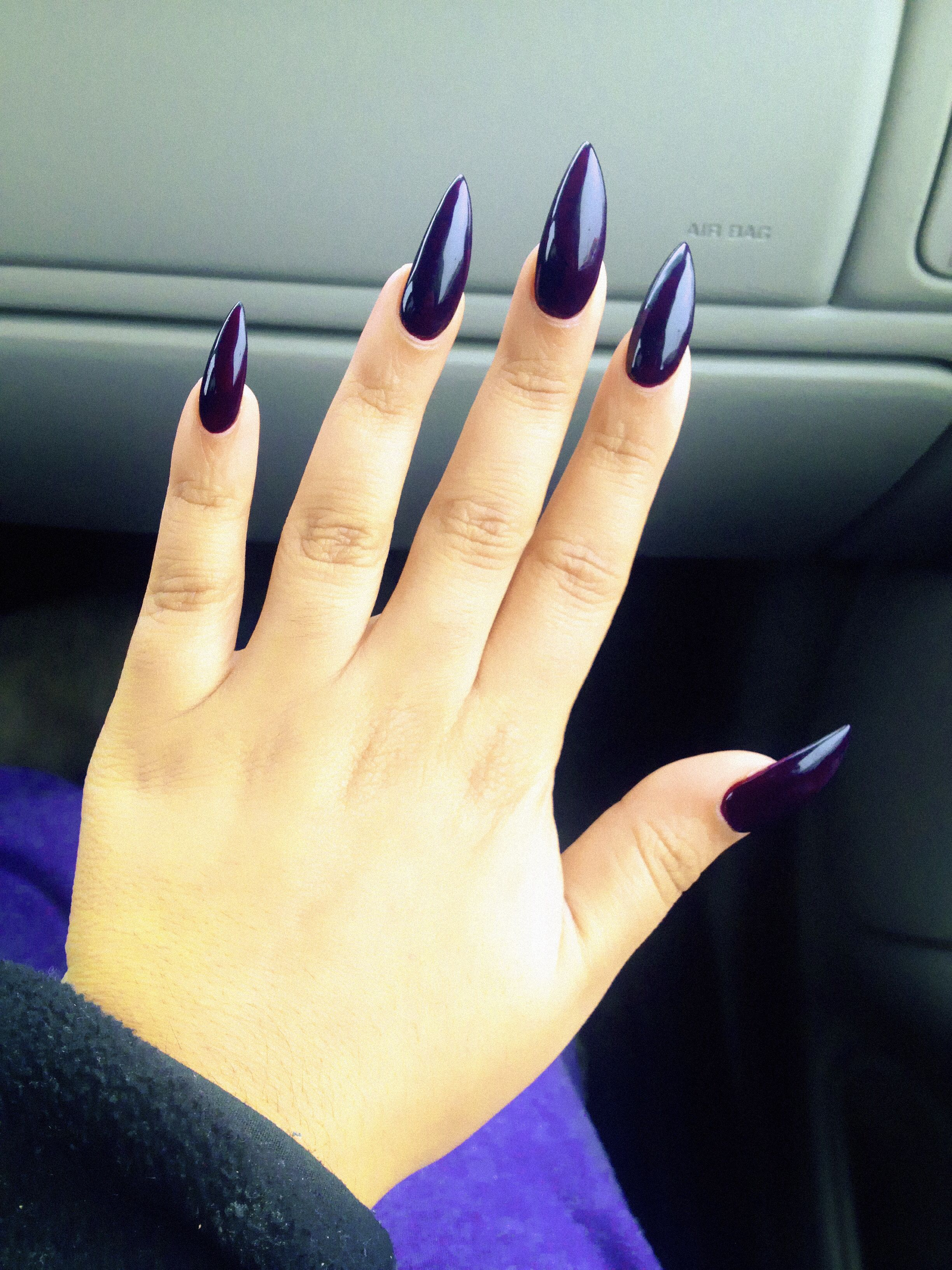 Stilleto nails with Sally Hanson pat on the black