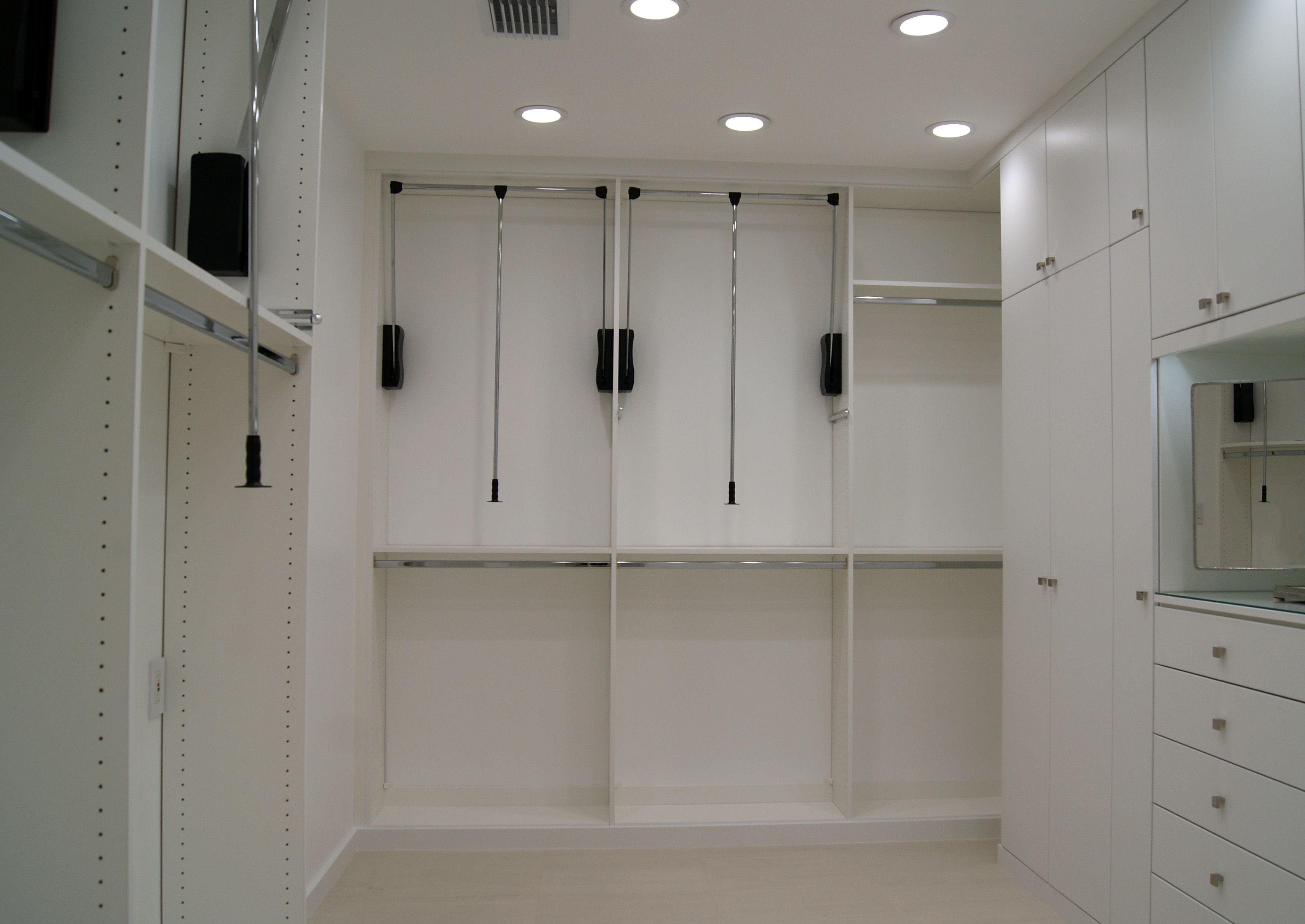 Pull Down Hanging Rods Utilize The High Ceilings In This